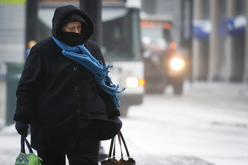 person walking during snowstorm