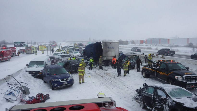 responders work at the scene of a chain-reaction pileup on Interstate 41