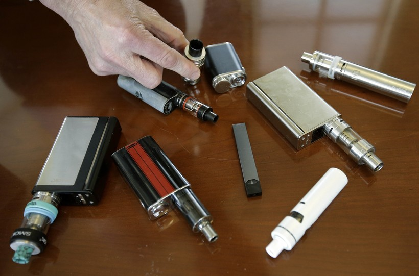 principal displays vaping devices that were confiscated from students