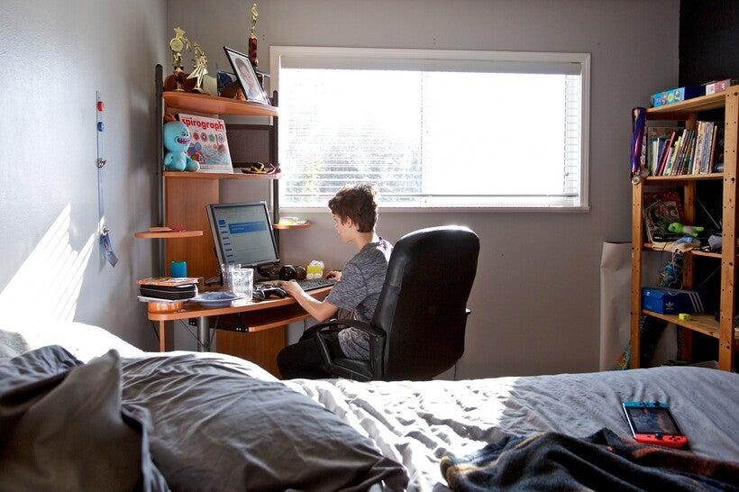 Elliott Bucks works on an online class assignment from his sixth grade class