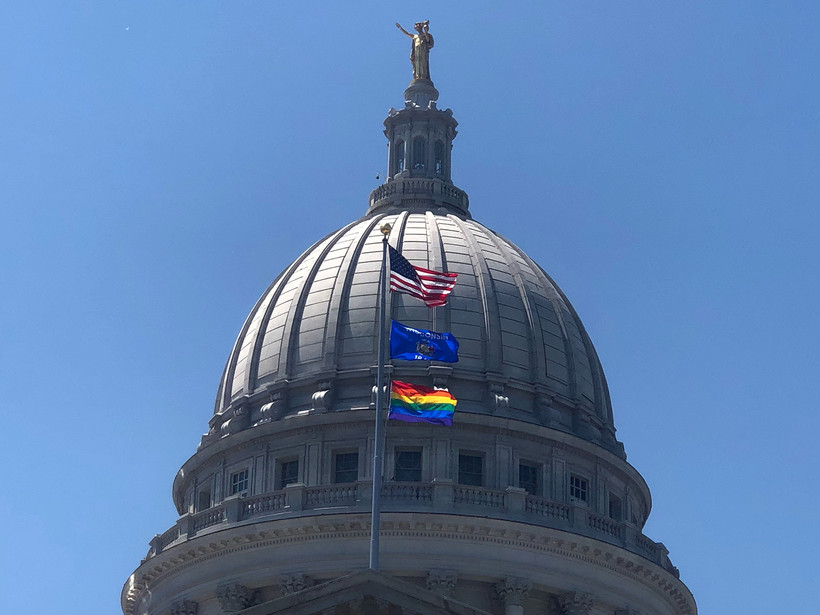 "A rainbow flag flies over the state Capitol in recognition of ""Pride Month"""