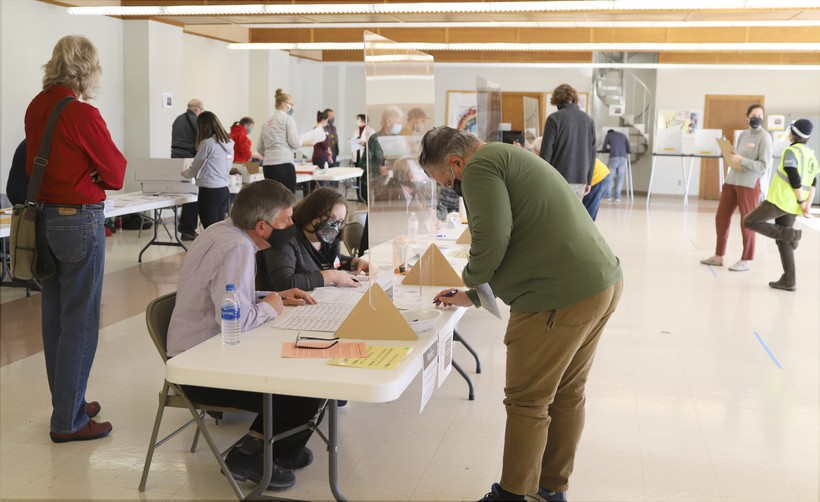 A voter checks in with poll workers atLakeview Lutheran Church on Madison's north side