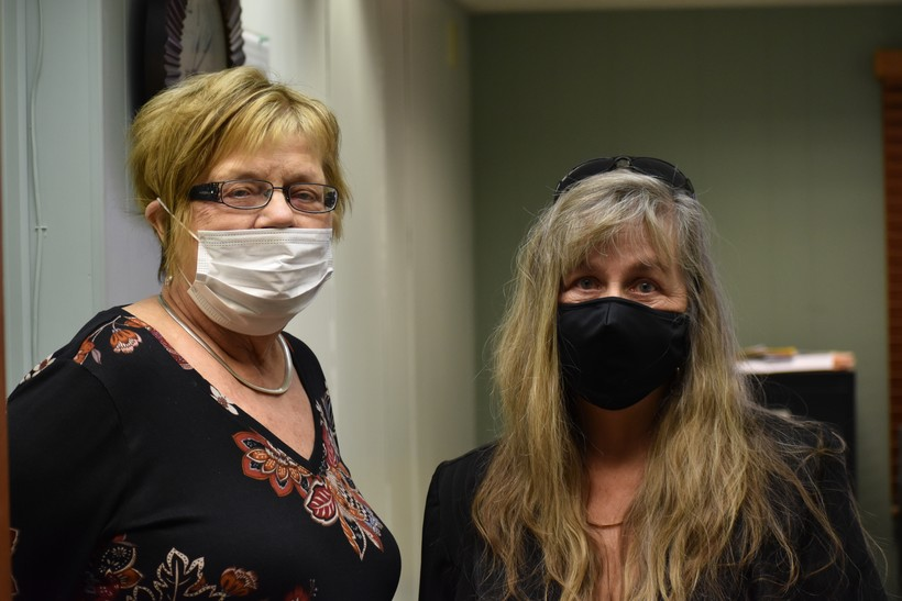 Two voters wearing face masks