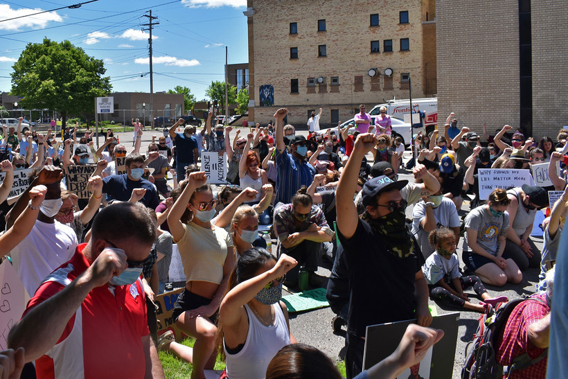 Protesters rally in front of Wausau's City Hall on Saturday
