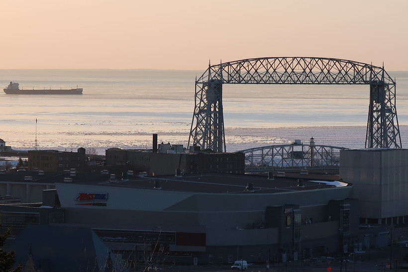 A vessel sits just beyond the Duluth Aerial Lift Bridge