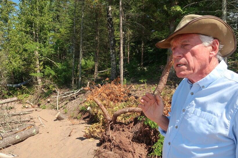 Theron O'Connor details shoreline erosion near his grandfather's cabin.