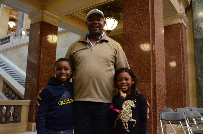 Jean-René Watchou stands with his children, Kenzo-Samuel, 8 years old, and Leá-Rosalie, 5-and-a-half years old.