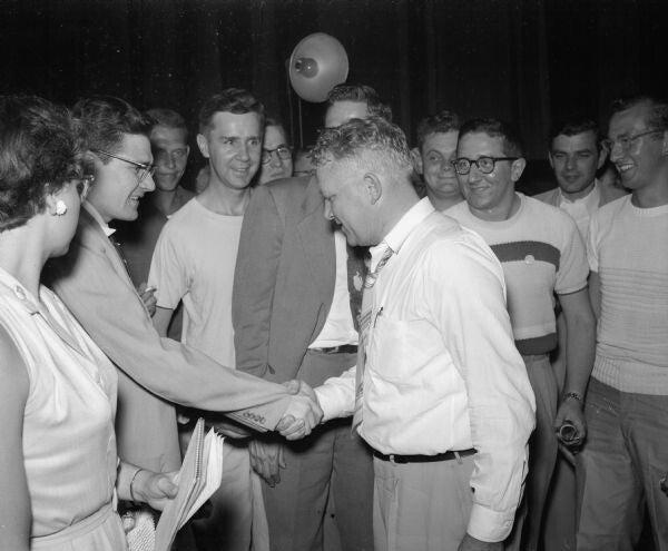 Leonard Schmitt shakes hands with well-wishers