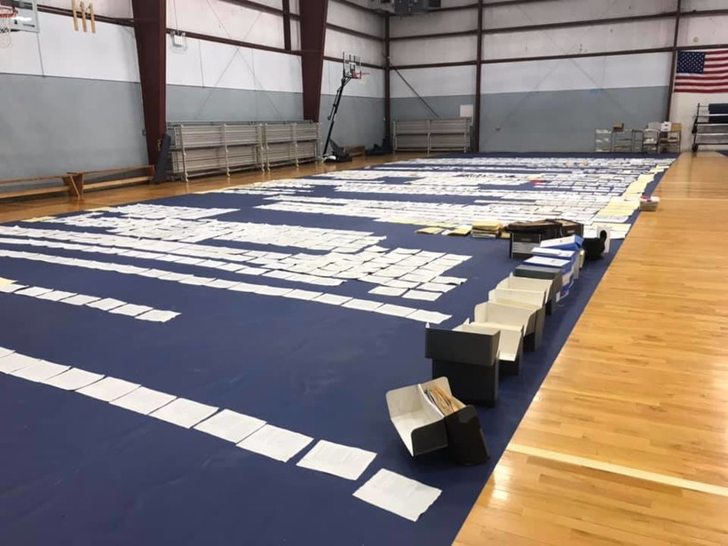 Papers from the Ho-Chunk Museum's archives are laid out in the gymnasium of the Ho-Chunk Youth Center