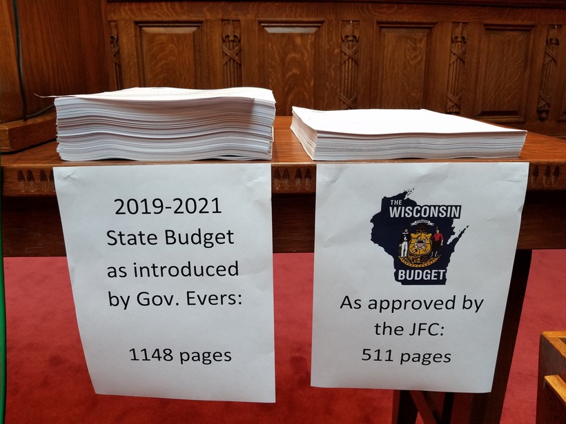 Gov. Tony Evers' budget bill stacked next to the Republican budget bill