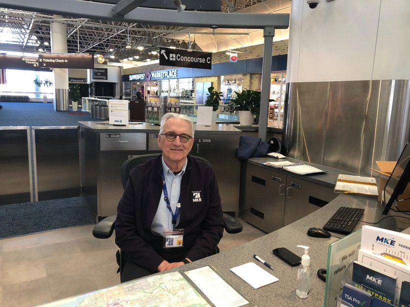 Peter Lee works at the Mitchell International Airport information desk