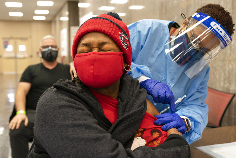 Jorie Winbish, 56, of Washington, receives her second dose of the COVID-19 vaccine