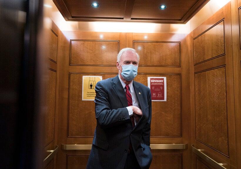 Sen. Ron Johnson, R-Wis., steps into an elevator
