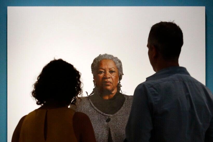 Visitors view a portrait of Nobel laureate Toni Morrison