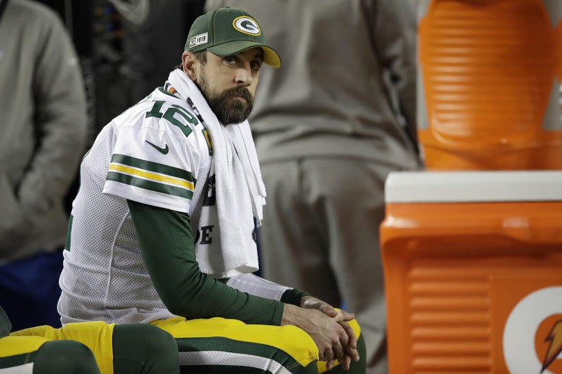 Aaron Rodgers sits on the bench