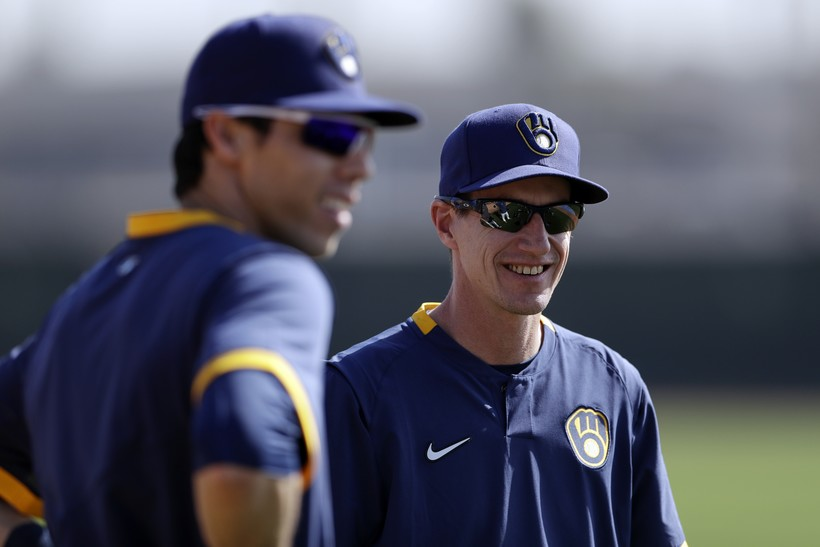 Christian Yelich and Craig Counsell chat at Spring Training