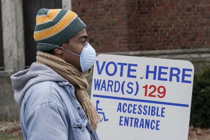 Voters masked against coronavirus line up at Riverside High School for Wisconsin's primary election Tuesday April 7, 2020, in Milwaukee.