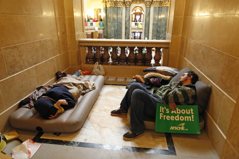Protesters take a break inside the State Capitol
