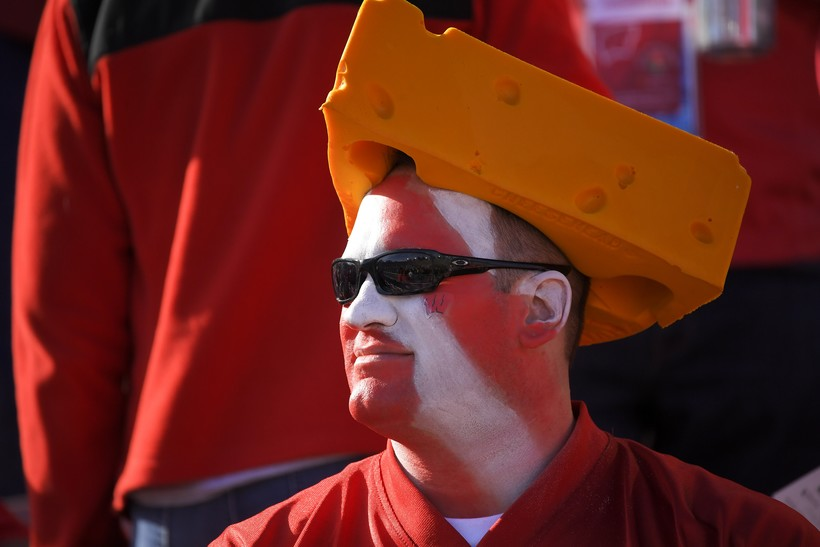 A Badgers fan dons a cheesehead at the Rose Bowl