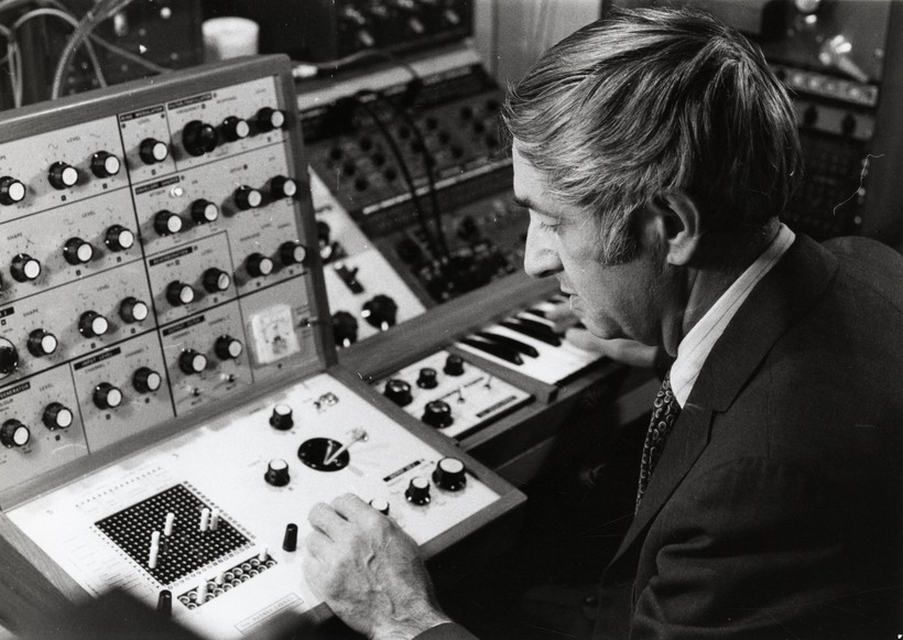 Composer Don Voegeli with his Putney synthesizer.