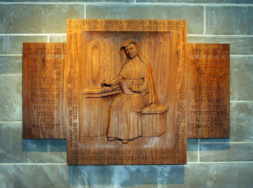 Sister Regine Collins' wood carving of Blessed Theresa Gethardinger, founder of School Sisters of Notre Dame. The carving is at Mary Our Queen Cathedral in Baltimore and includes the countries the SSND can be found in.