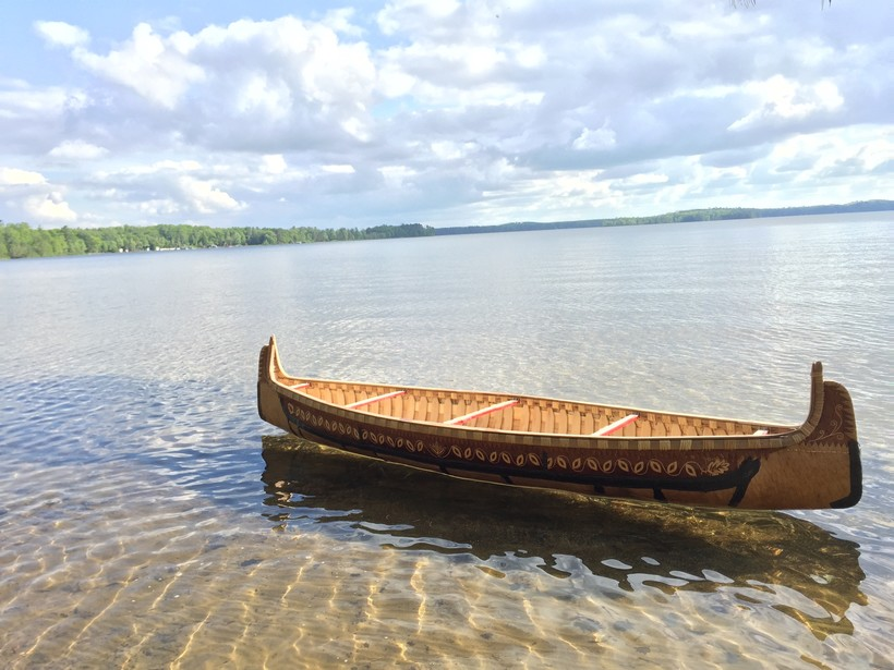 A birchbark canoe built by Wayne Valliere floats in the water