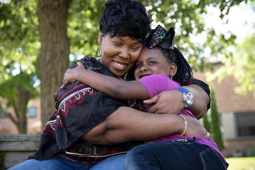 Alfreida Casterlow hugs her granddaughter