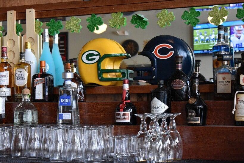 Packers and Bears helmets displayed at Murray's Irish Pub in Menominee, MI