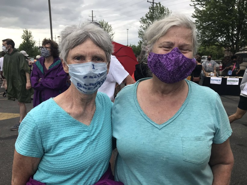 Margie Pecus, 80, left, and Margaret Ward, 73 right, appeared at Wauwatosa protest on Tuesday evening.