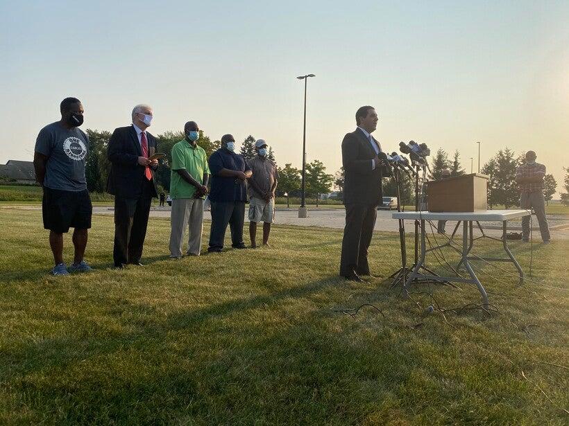 Josh Kaul speaks at a press conference in Kenosha.