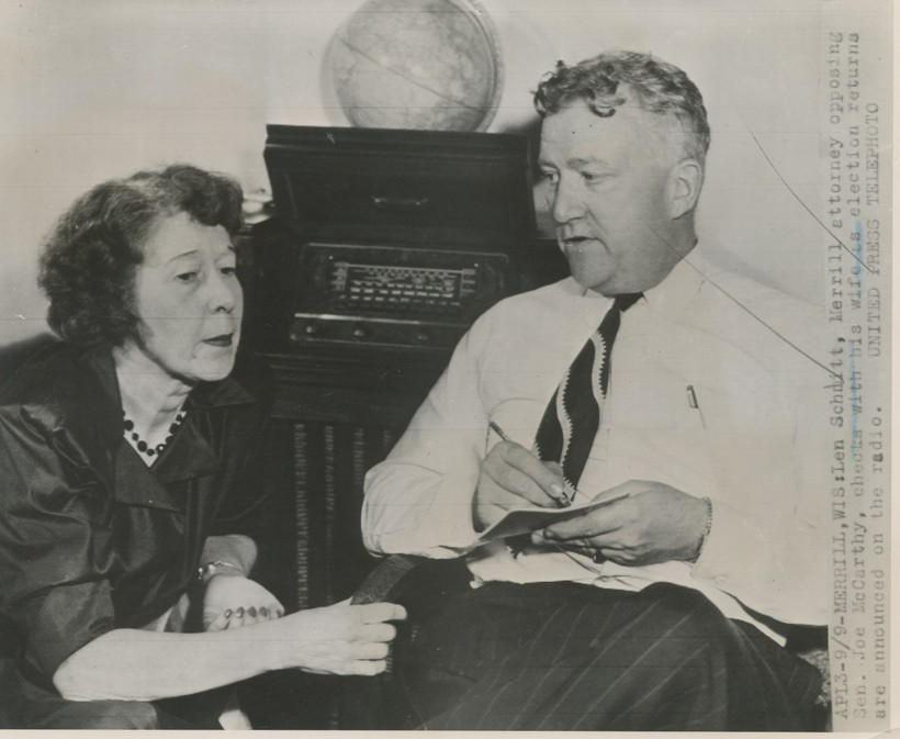Len Schmitt, Merrill attorney opposing Sen. Joe McCarthy, checks with this wife as election returns are announced on the radio