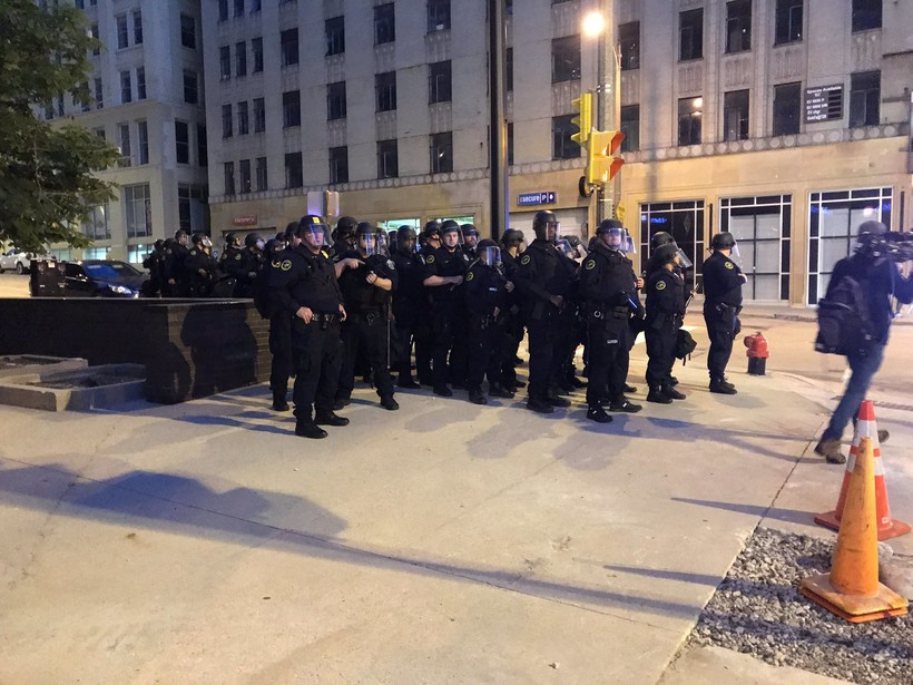 Police assemble close to the start of the citywide curfew on Monday night, June 1, 2020.