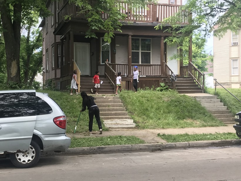 Milwaukee resident Epiphany Conner brought a broom and trash bags to North 40th street and West Lloyd Street.