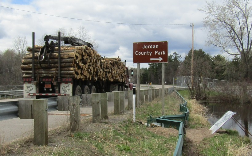 A logging truck passes over the turtle underpass on Highway 66 outside Stevens Point.