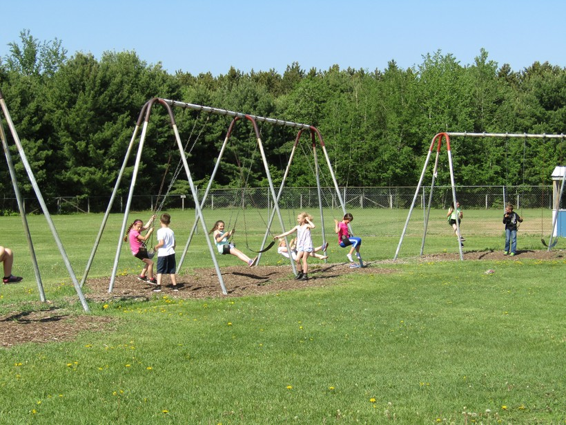 Students swing during recess at Langlade County's Pleasant View Elementary School