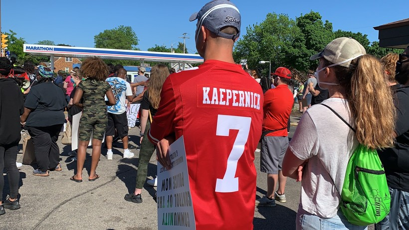 A protester in Wauwatosa wears a Colin Kaepernick jersey