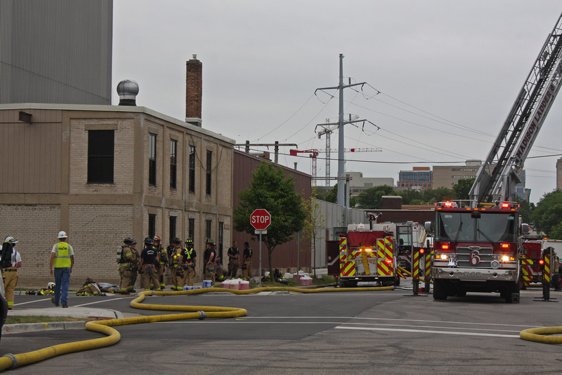 Madison firefighters and Madison Gas and Electric staffafter a fire was put out