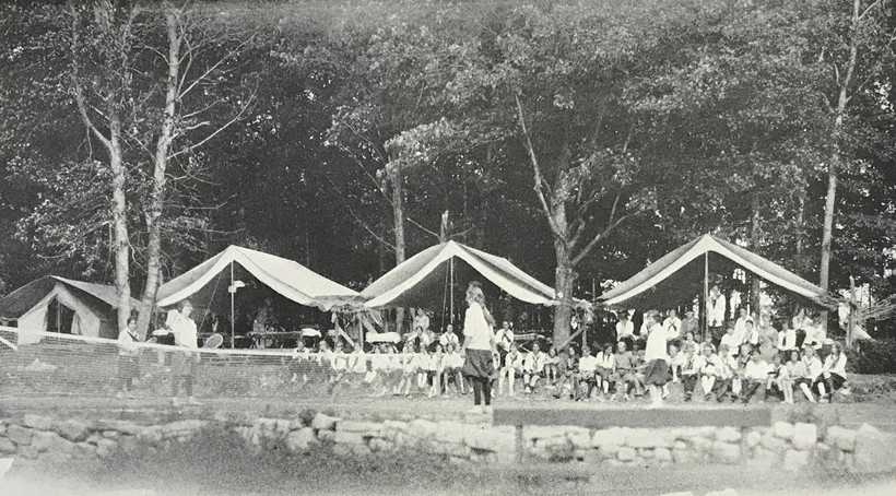 Camp Meenahga's 1928 brochure included an image of a row of canvas tents where the girls slept