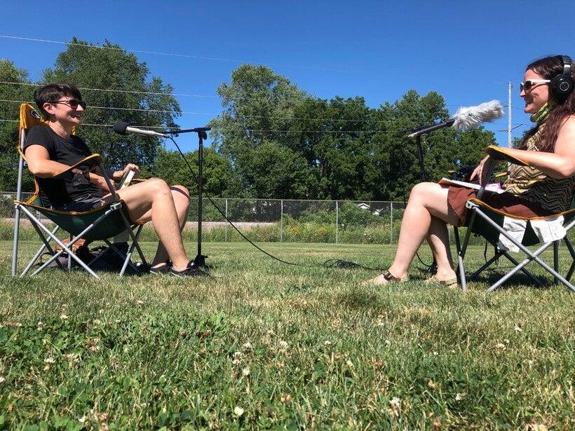 "Writer Melissa Faliveno (left) and WPR's Maureen McCollum talk about ""Tomboyland"" in center field at an Olbrich Park softball field on August 11, 2020. Maureen McCollum/WPR"