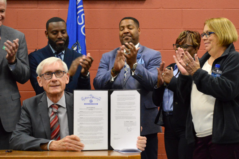 Gov. Tony Evers signs an executive order for a Complete Count Committee for the 2020 census