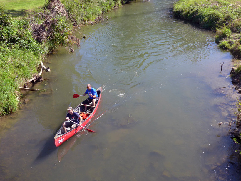 A team crosses the finish line of the Coon Creek Canoe Race