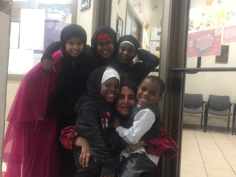 Rafat Arain with children she cares for at Crescent Learning Center in Milwaukee