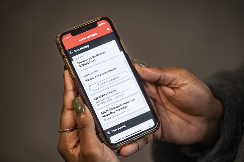 UW-Madison student Kingsley Pissang uses the Safer Badgers phone app to schedule a COVID-19 saliva test