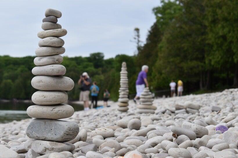 Limestone rocks are piled up on Schoolhouse Beach on Washington Island