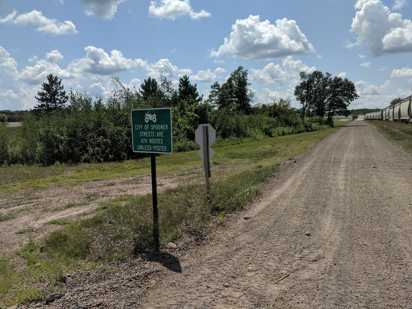 A sign at a trail in Spooner in Washburn County notifies users that ATVs are allowed on city streets unless otherwise posted