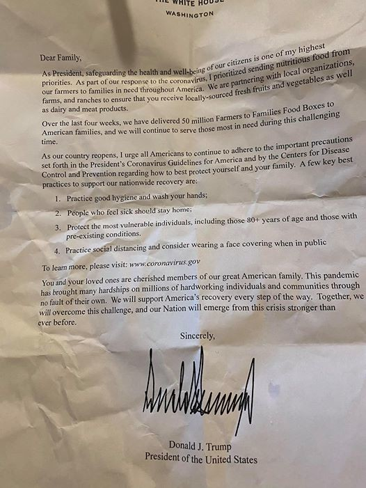 A letter from President Trump included in Wisconsin food boxes