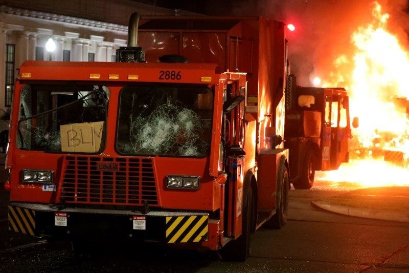 A garbage truck is set ablaze in Kenosha