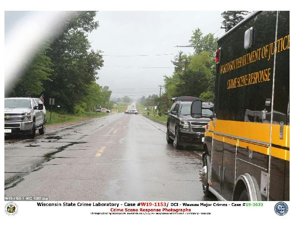 Emergency vehicles outside the site of June 11 police shooting in Arpin