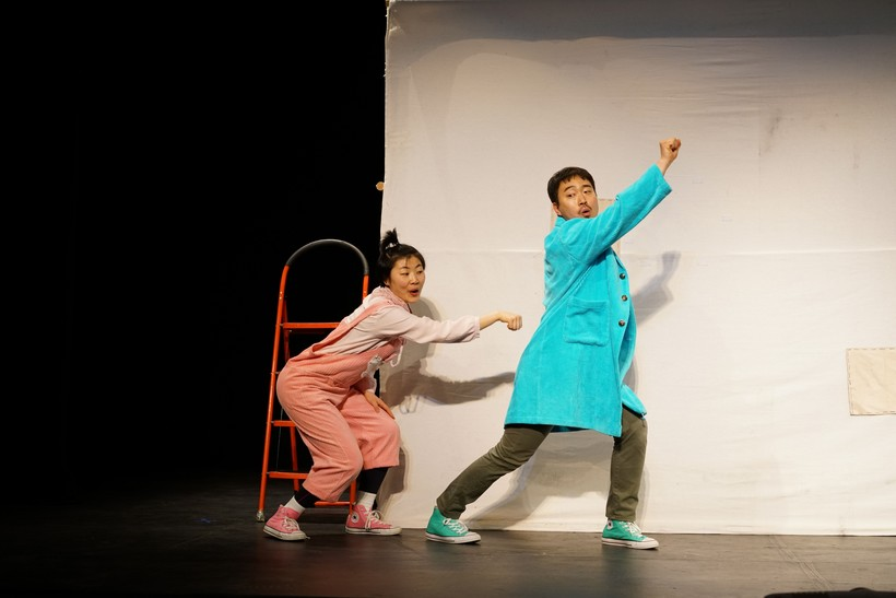 Two young actors performing on theater stage