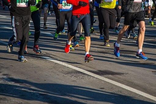 Runners' feet on pavement.